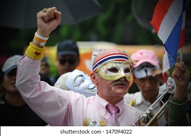 "BANGKOK - JULY 21: A masked protester attends an anti-government rally on July 21, 2013 in Bangkok, Thailand. The protesters known as ""V for Thailand"" call for the government to be overthrown."