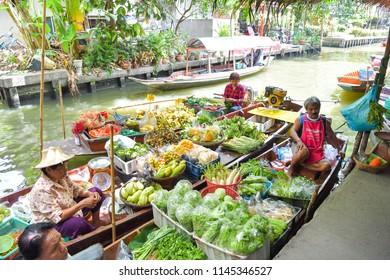 BANGKOK - JULY 29 : Farmer selling fruit vegetable and food on boats at Khlong Lat Mayom floating market, famous and popular among locals and tourists, on July 29, 2018 at Bangkok, Thailand.