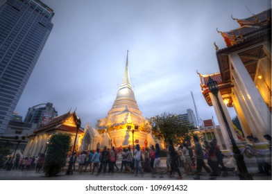 BANGKOK - JULY 29 : Thai Buddhists gather together to hold the holy ceremony by walking with lighted candles in hand around a temple to celebrate ASALAHA BUCHA on 29 July 2012 at Phatumwanaram temple.