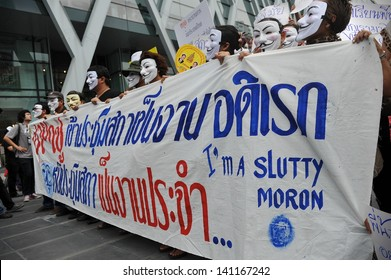 BANGKOK - JUN 2: Anti-government protesters wearing Guy Fawkes masks rally in Bangkok's shopping district on Jun 2, 2013 in Bangkok, Thailand. The protesters call for the government to be overthrown.