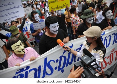 BANGKOK - JUN 2: Protesters wearing Guy Fawkes masks give an interview to media at an anti-government rally in Bangkok's shopping district on Jun 2, 2013 in Bangkok, Thailand.