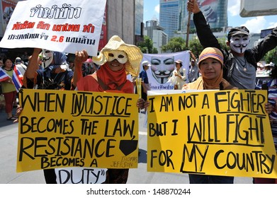 BANGKOK - JUN 30: Protesters join an anti-government rally in Bangkok's shopping district on Jun 30, 2013 in Bangkok, Thailand. Protesters rallied against the government and PM Yingluck Shinawatra.