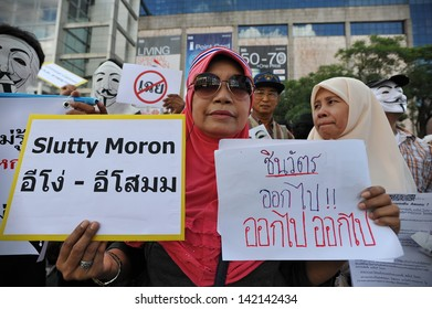 BANGKOK - JUN 9: A protester joins an anti-government rally in Bangkok's shopping district on Jun 9, 2013 in Bangkok, Thailand. Protesters rallied against the government and PM Yingluck Shinawatra.