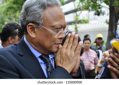 BANGKOK - JUNE 1: Former Deputy Prime Minister Suthep Thaugsuban leaves Parliament and greets PAD demonstrators on June 1, 2012 in Bangkok.