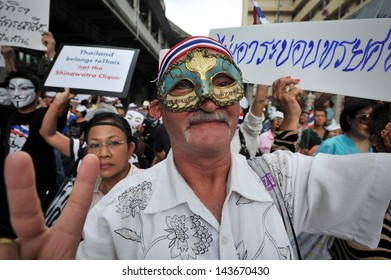 BANGKOK - JUNE 16: A protesters wearing a mask joins a large anti-government rally in Bangkok's shopping district on June 16, 2013 in Bangkok, Thailand.