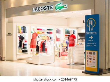 BANGKOK - JUNE 17: Lacoste Store in Suvarnabhumi Airport, Bangkok on Jun 17, 2014. Lacoste is a French apparel company that sells high-end clothing, most famously tennis shirts.