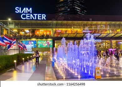 BANGKOK - JUNE 17: People walk through courtyard between Siam Paragon and Siam Center Shopping mall at night on June 17, 2017. Siam Center re-open in January 11, 2013.