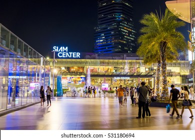 BANGKOK - JUNE 17: People walk through courtyard between Siam Paragon and Siam Center Shopping mall at night on June 17, 2016. Siam Center re-open in January 11, 2013.