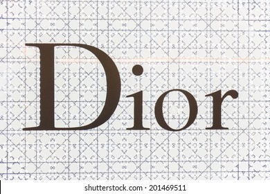 BANGKOK - JUNE 17: The sign of Dior at Dior store on Jun 17, 2014 in Suvarnabhumi  Airport, Thailand. It is a French company controlled and chaired by Bernard Arnault who also heads Louis Vuitton.