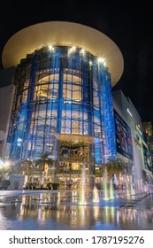 BANGKOK - JUNE 18, 2020 : In front of Siam Paragon Shopping mall at night. Tourists are walking around Park Paragon area. Siam Paragon is one of the biggest shopping centres in Asia.