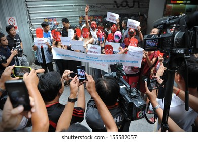 BANGKOK - JUNE 2: Media gather to cover a Red Shirts rally in support of the government on June 2, 2013 in Bangkok, Thailand. The Red Shirts met counter an opposition group's anti-government rally.