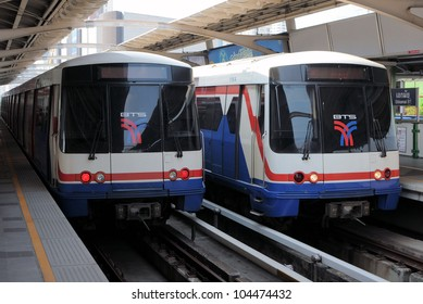 BANGKOK - JUNE 2: Two BTS Skytrains at a station on Sukhumvit Road on June 2, 2011 in Bangkok, Thailand. The rail network recently marked its 10th year of operations in the Thai capital.
