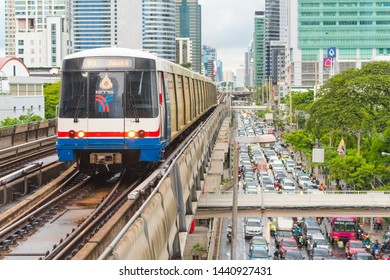 Bangkok - June 25, 2019: a train travels towards Surasak BTS Station above the traffic jam on Sathon Tai Road in the downtown.