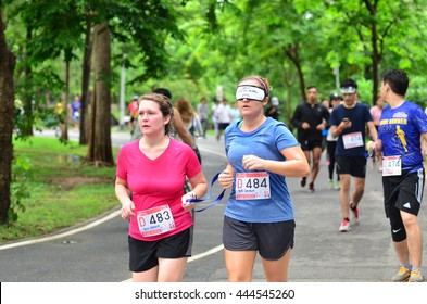 BANGKOK - JUNE 26 : Unidentified marathon runner at Run For The Blind # 2, Helping the blind to be able to run like normal person, on June 26, 2016 Bangkok, Thailand.
