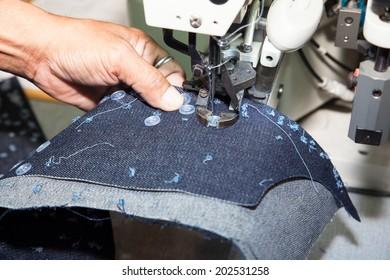 BANGKOK - JUNE 28 :Auto sewing buttons machine at Garment Manufacturers Sourcing 2014 on June 28,2014 in BITEC ,Bangkok, Thailand.