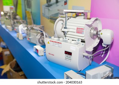 BANGKOK - JUNE 28 :Motor spare parts of sewing machine at Garment  Manufacturers Sourcing 2014 on June 28,2014 in BITEC ,Bangkok,  Thailand.