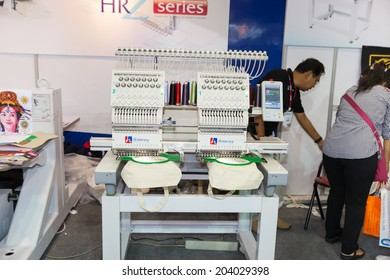 BANGKOK - JUNE 28 :Textile embroidery machine in Textile Industry at  Garment Manufacturers Sourcing 2014 on June 28,2014 in BITEC ,Bangkok,  Thailand.