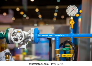 BANGKOK - JUNE 4 : Steam pipe with a valve and manometer at Renewable Energy Environmental Technology on June 4,2014 in BITEC ,Bangkok, Thailand.