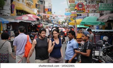 BANGKOK - JUNE 5: Unidentified tourists walk along the backpacker landmark Khao San Road on June 5, 2013 in Bangkok, Thailand. Budget accommodation on Khao San Road starts from $6 or B200 per night.