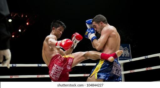 "BANGKOK - JUNE 9: Muay Thai Welterweight World Championship fight - Big Ben Ch. Praram 6 (Thailand) kicking Fabio Pinca (France) at ""BATTLE FOR THE BELTS"" event on June 9, 2012 in Bangkok, Thailand"