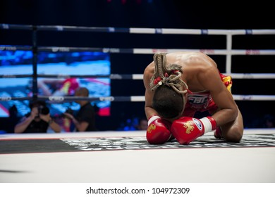 "BANGKOK - JUNE 9: Muay Thai Super Lightweight World Championship - Jomtong Chuwattana (Thailand) praying ritual before the fight at ""BATTLE FOR THE BELTS"" event on June 9, 2012 in Bangkok, Thailand"