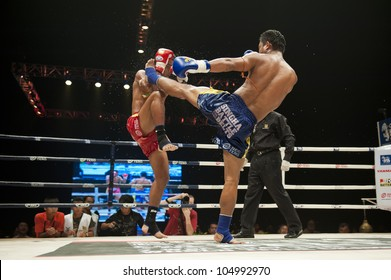 """BANGKOK - JUNE 9: Muay Thai fight - two unidentified thai kickboxer at """"BATTLE FOR THE BELTS"""" event on June 9, 2012 in Bangkok, Thailand"""