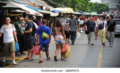 BANGKOK - MAR 16: Unidentified shoppers browse Chatuchak Weekend Market on Mar 16, 2013 in Bangkok, Thailand. Chatuchak is one of the world's largest markets covering over 35 acres with 15,000 stalls