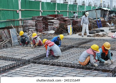 BANGKOK - MAR 19:  Labourers work on a city centre construction site on Mar 19, 2013 in Bangkok, Thailand. The Thai capital is seeing a construction boom with numerous new buildings and projects.