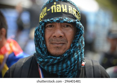 BANGKOK - MAR 28: An anti-government protester takes part in a rally at government buildings on Mar 28, 2014 in Bangkok, Thailand. The protest movement calls for political reform before elections.