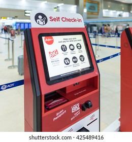 BANGKOK - MAR 29: Air Asia self check-in service counter at Don Mueang International Airport on March 29, 2016 in Bangkok,Thailand. Air Asia has been the world's best low-cost airline