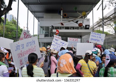 BANGKOK - MARCH 13: Thai NXP workers protest infront of the Royal Netherlands Embassy on March 13, 2013 in Bangkok, Thailand. Union workers gathered to request better wages and work conditions.