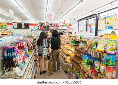 BANGKOK - MARCH 16, 2016 : Unidentified people buy goods at a 7-Eleven shop. 7-Eleven (7-11) is an international chain of convenience stores that operates some 58,300 stores in 17 countries.