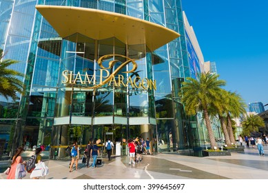 BANGKOK - MARCH 17, 2016 : People walk in and out of the Siam Paragon Shopping mall. It is one of the biggest shopping centres in Asia.