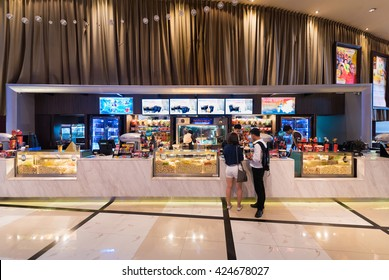 BANGKOK - MARCH 17, 2016 : Unidentified people buy food at a snack bar of Paragon Cineplex in the Siam Paragon shopping mall. With 16 screens and 5,000 seats, it is Thailands largest movie theater.