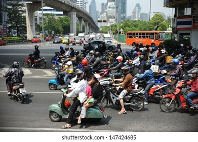 BANGKOK - MARCH 19: Motorcyclists wait at a junction during rush hour on March 19, 2013 in Bangkok, Thailand. Motorcycles are often the transport of choice for Bangkok's heavily congested roads.