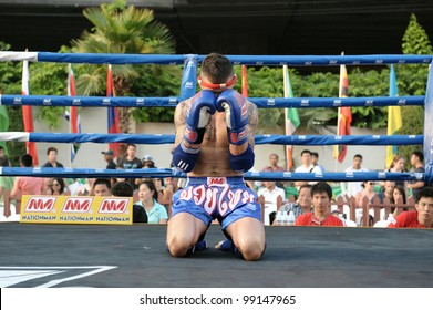 BANGKOK - MARCH 20: An unidentified Muay Thai fighter warms up before a match in the World Amateur Muay Thai Championships at the National Stadium on March 20, 2012 in Bangkok, Thailand.