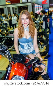 """BANGKOK - MARCH 24 : Harley-Davison 2015 V-Rod Night Rod Special with Unidentified Model on display at The 36th Bangkok International Motor Show """"Art of Auto"""" on March 24, 2015 in Bangkok, Thailand."""