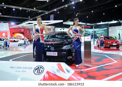BANGKOK - MARCH 26 :MG 6 car with Unidentified model   on display at The 35th Bangkok International Motor Show 2014 on March 26, 2014 in Bangkok, Thailand
