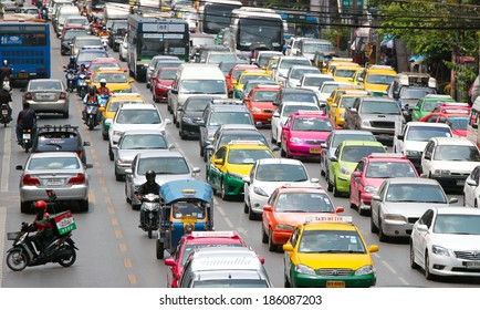 BANGKOK - MARCH 26 : Traffic approaching a dead end on a busy street in the city center, on 26 March 2014 in Bangkok, Thailand. Congested roads Bangkok.