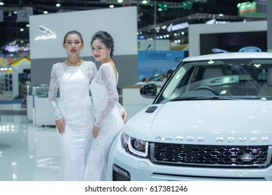 BANGKOK - March 28, 2017 : Unidentified models with Range Rover car on display at the 38th BANGKOK INTERNATIONAL MOTOR SHOW 2017 on March 28, 2017 in Bangkok, Thailand.