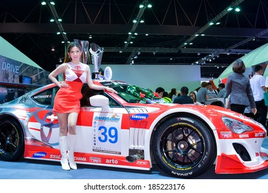 BANGKOK - MARCH 30 : Unidentified model with Toyota on display at The 35th Bangkok International Motor Show on March 30, 2014 in Bangkok, Thailand