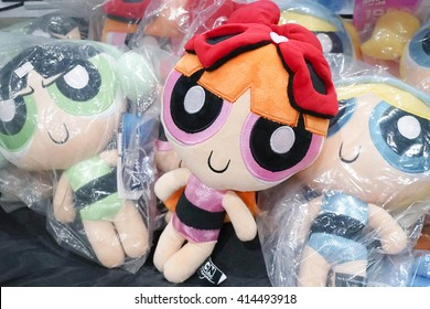 BANGKOK - MAY 1, 2016 : Photo of Big pile of Cartoon Network Merchandise soft toys from Powerpuff Girls. Character names from left to right : Buttercup (green), Blossom (pink), Bubble (blue). Brighter