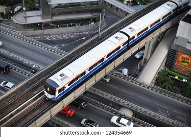 BANGKOK - MAY 11: Birds eye view of a BTS Skytrain on elevated rails in Silom district on May 11, 2012 in Bangkok, Thailand. Each train of the mass transport network can carry over 1,000 passengers.