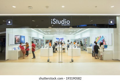 BANGKOK - MAY 13: People shop in Istudio shop, Central Embassy on May 13, 2014. It is a premium reseller of Apple Inc in Thailand.