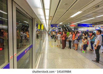 BANGKOK - MAY 19: Travelers waiting the train at Ladprow station on may 19, 2013 in Bangkok, Thailand. MRT (Metropolitan Rapid Transit) is the fist subway system in thailand