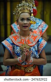 BANGKOK - MAY 24: An unidentified troupe perform classical Thai dance or Lakhon Nai at the Erawan Shrine on May 24, 2013 in Bangkok, Thailand. Lakhon Nai originated in the royal court of Thailand.
