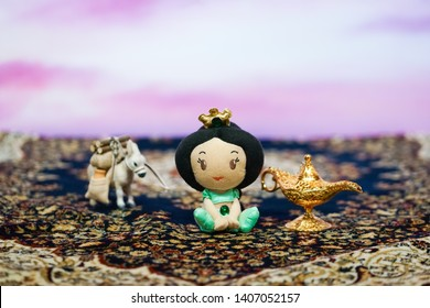 Bangkok - May 25, 2019 : A photo of Princess Jasmine baby plush doll, Aladdin's lamp and a donkey animal on magic carpet. Promote in front of theatre. Movie standee of a magic carpet - Aladdin (2019)