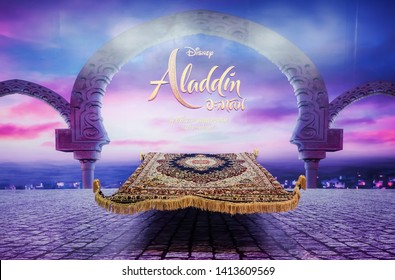 Bangkok - May 26, 2019 : A photo of movie standee of a magic carpet in front of a twilight scene in Aladdin to promote the movie Aladdin (2019) in cinema
