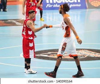 "BANGKOK - MAY 30:Leo Avenido (R) touch with Christien Charles(W) before ASEAN Basketball League ""ABL"" playoffs game4 at Nimitbut Stadium on May 30, 2013 in Bangkok,Thailand."