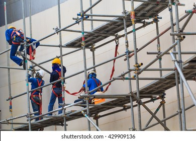 Bangkok - May 30th, 2016: Construction workers installing scaffolding storage tank.